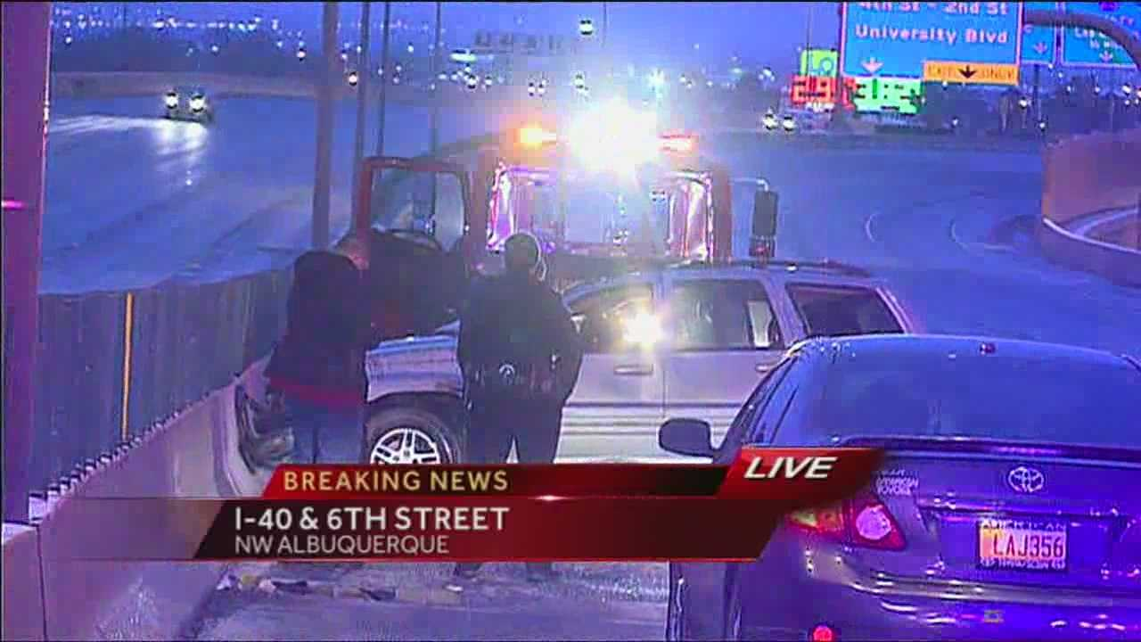 Icy roads are blamed for the accident on I-40 that spun one vehicle out and rolled another one over.