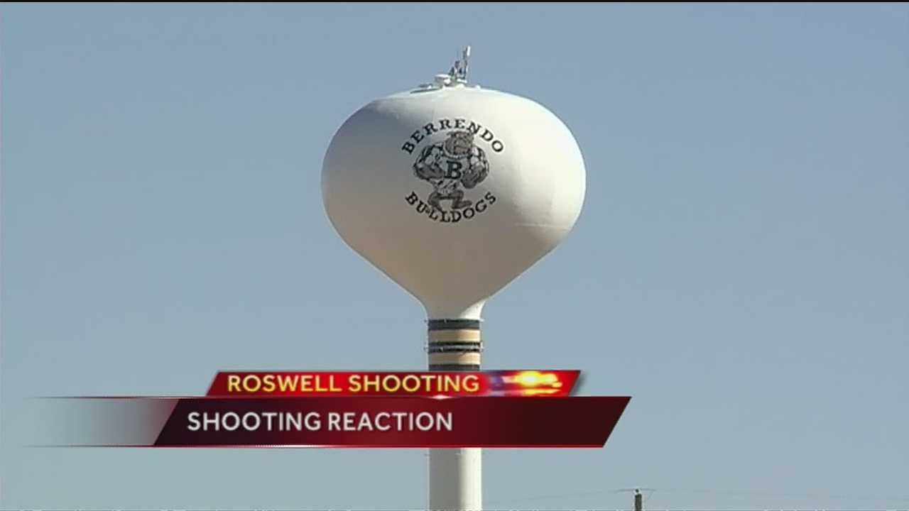 Victims' friends join crowds at Roswell shooting vigil