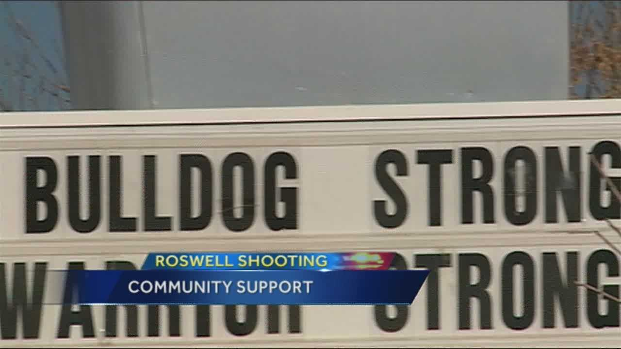 """As Roswell heals from this week's school shooting, people are doing what they can to help the community move on. Some have begun to hang sings that say """"Bulldog Strong"""" and """"You're in Our Prayers"""" around town."""