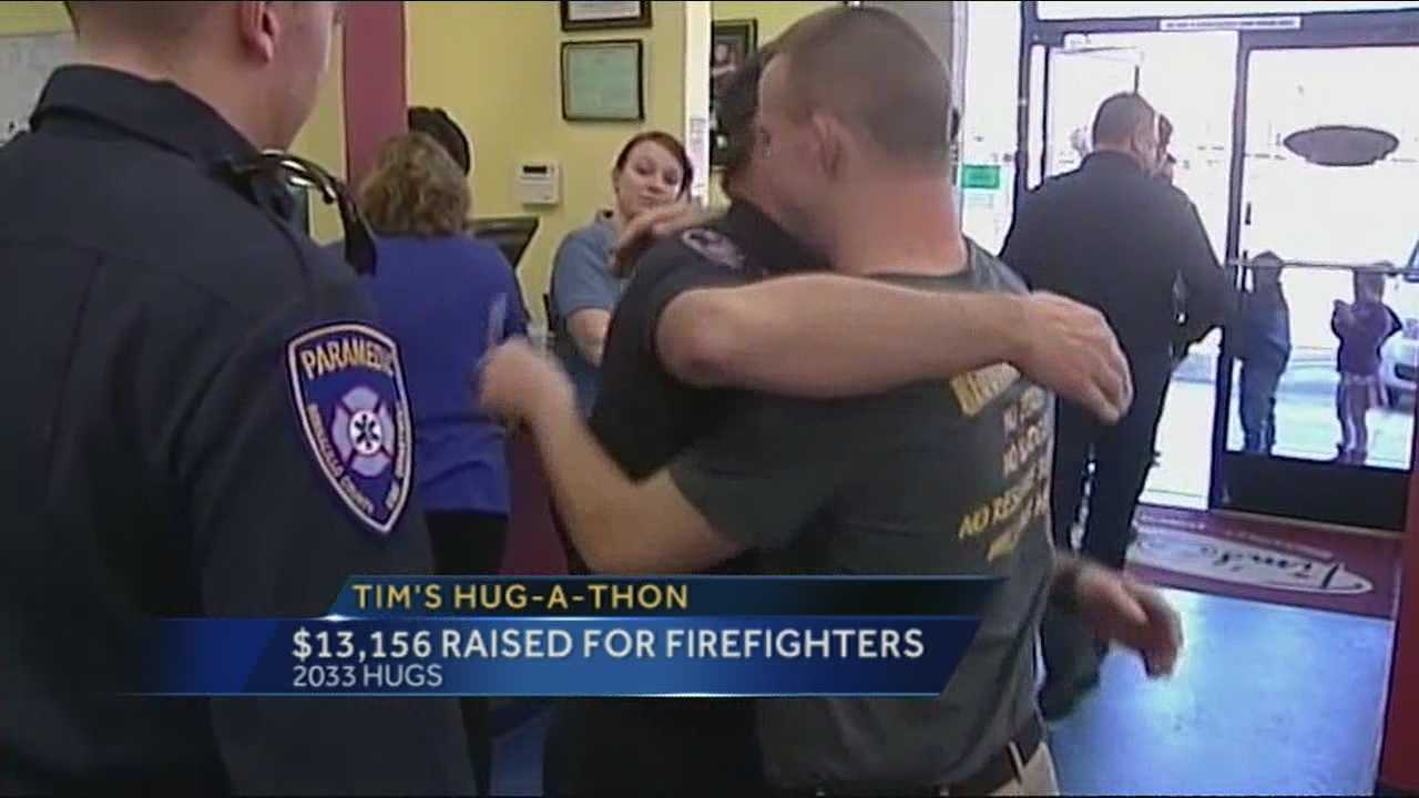The world's friendliest restaurant surpassed a goal to raise money for Albuquerque firefighters this weekend by giving out gobs of hugs.