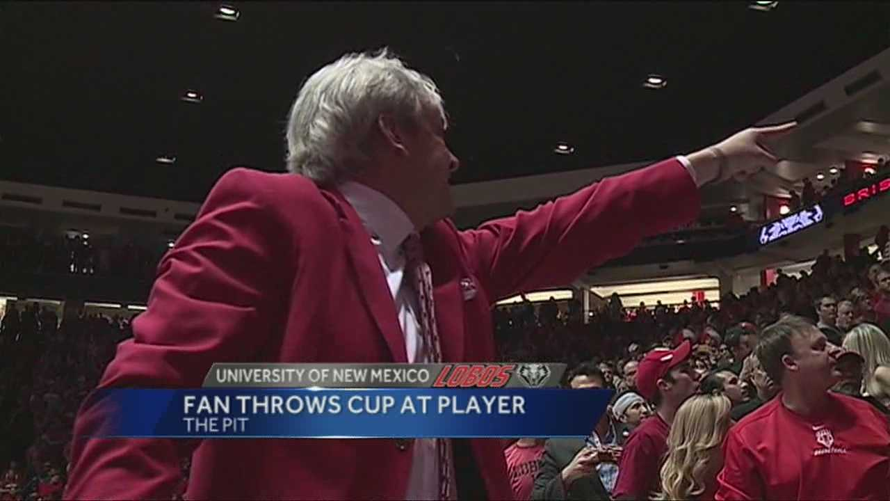 Fan throws cup at player