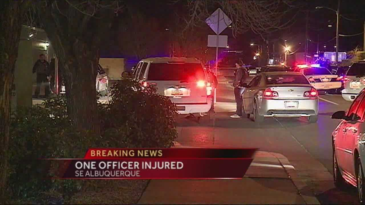 An unmarked APD car shot at, one officer injured