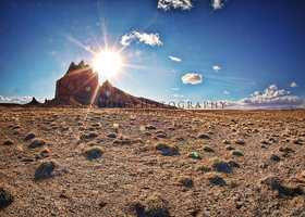 ShiprockThe sun peeking out from behind Shiprock.