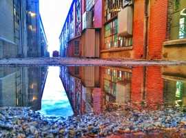 Double TakeReflection of buildings at the Albuquerque rail yards.