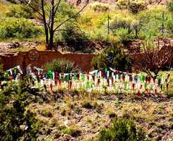 A new twist on recyclingThis multi-colored fence was made from discarded bottles that would have ultimately ended up in a landfill somewhere.