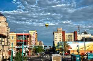 Balloon CityA balloon flies above downtown Albuquerque.
