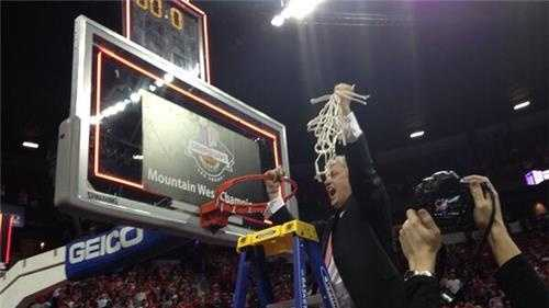 Craig Neal cuts down the nets