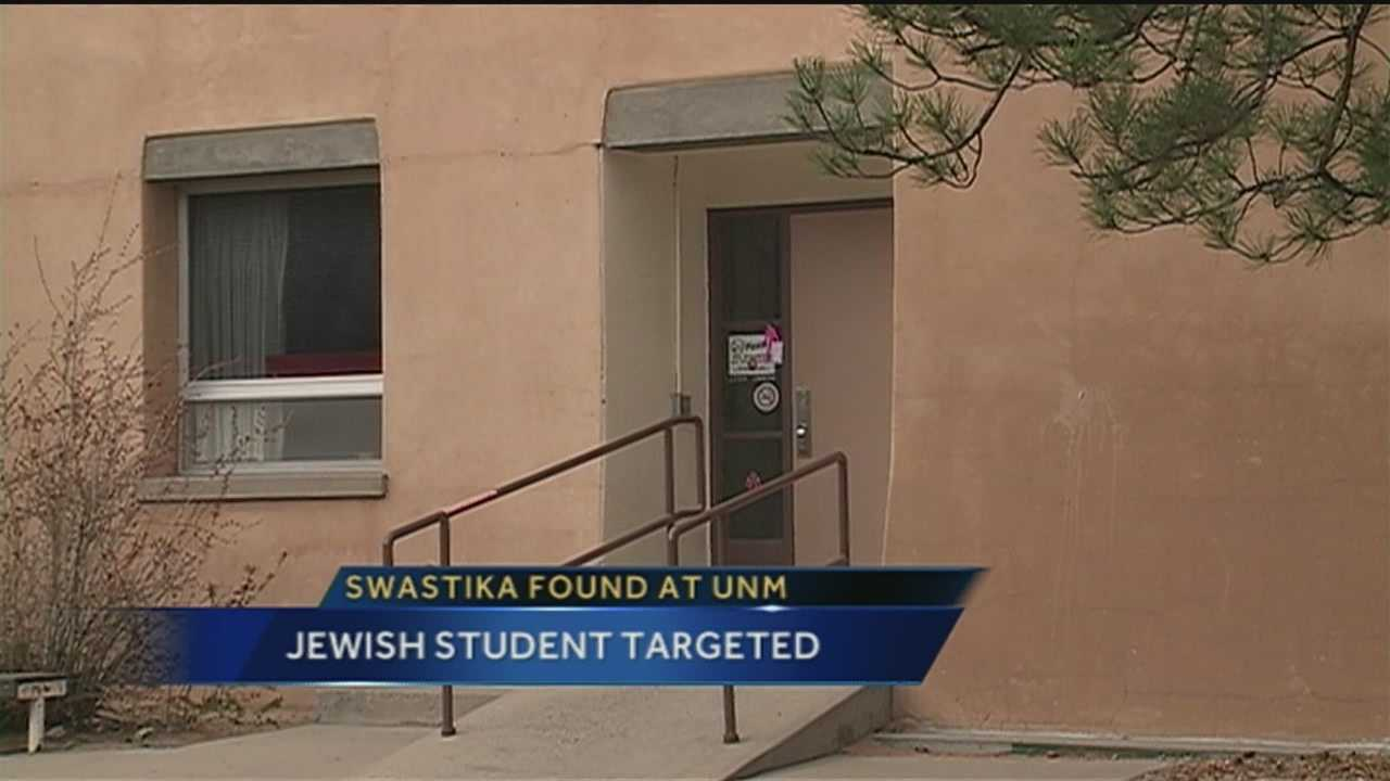 University of New Mexico Police are trying to find out who scratched a swastika onto a Jewish students dorm room door.