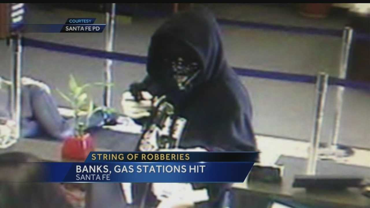 There's an 11-thousand-dollar reward for anyone who helps catch a bank robber in Santa Fe.  So far he's hit three banks.