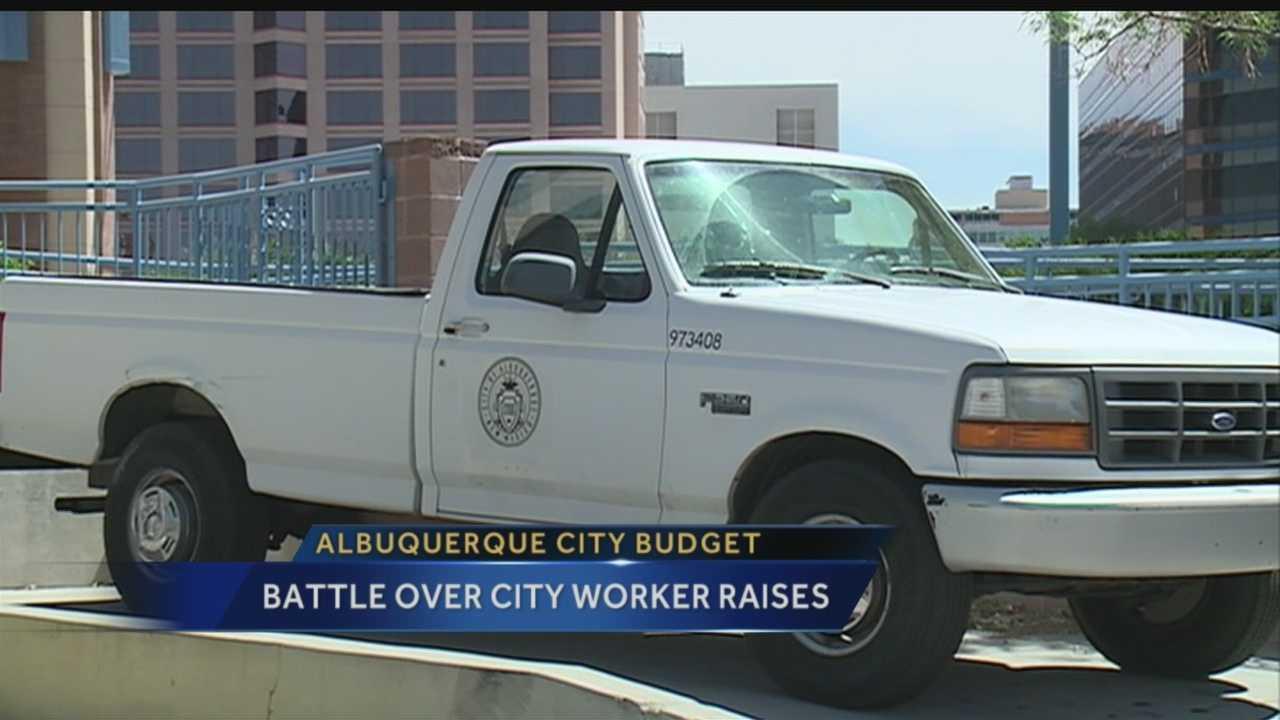 City budget: Battle over city worker raises