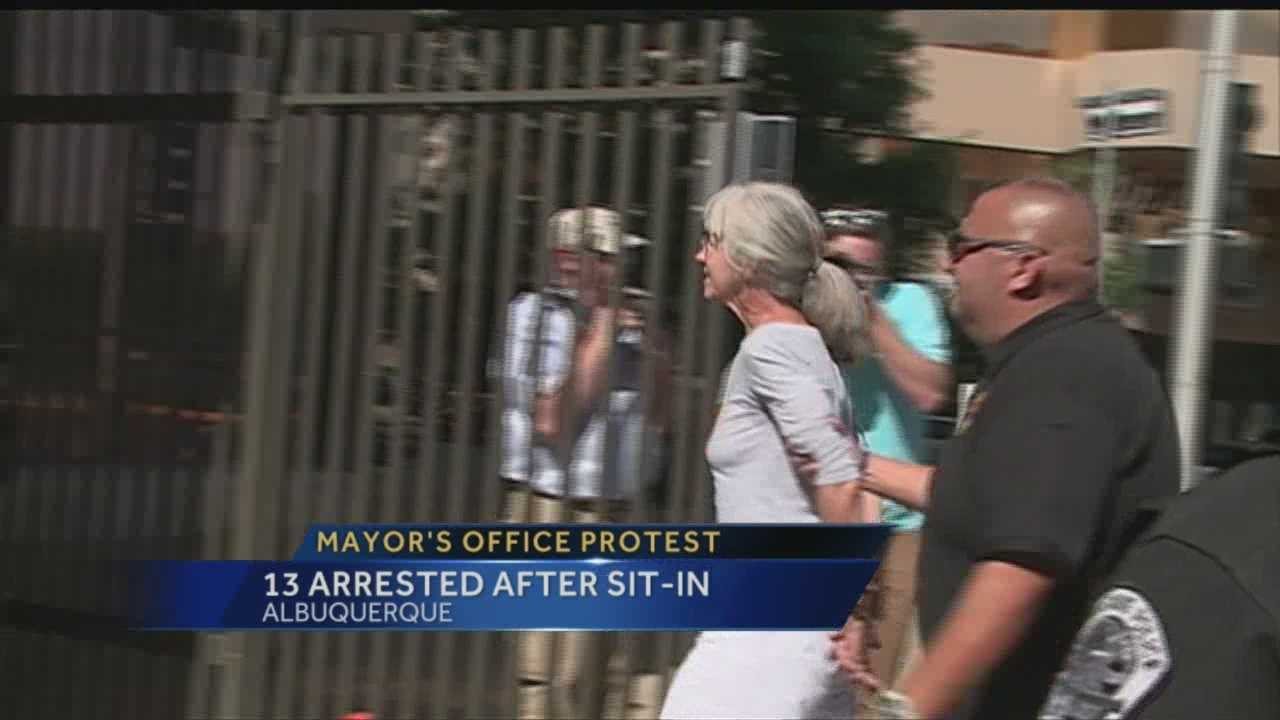 Mayor Berry out of town as protesters storm office