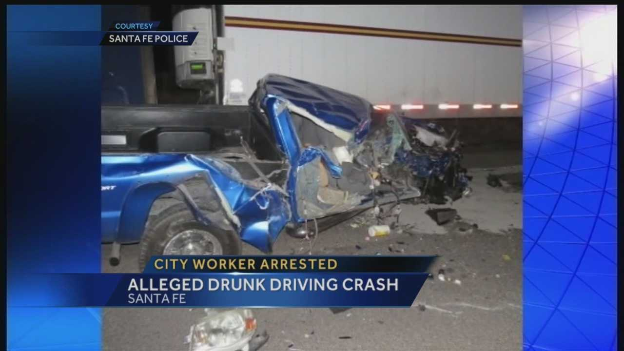 Drunken city worker slams into semi carrying acid, police say