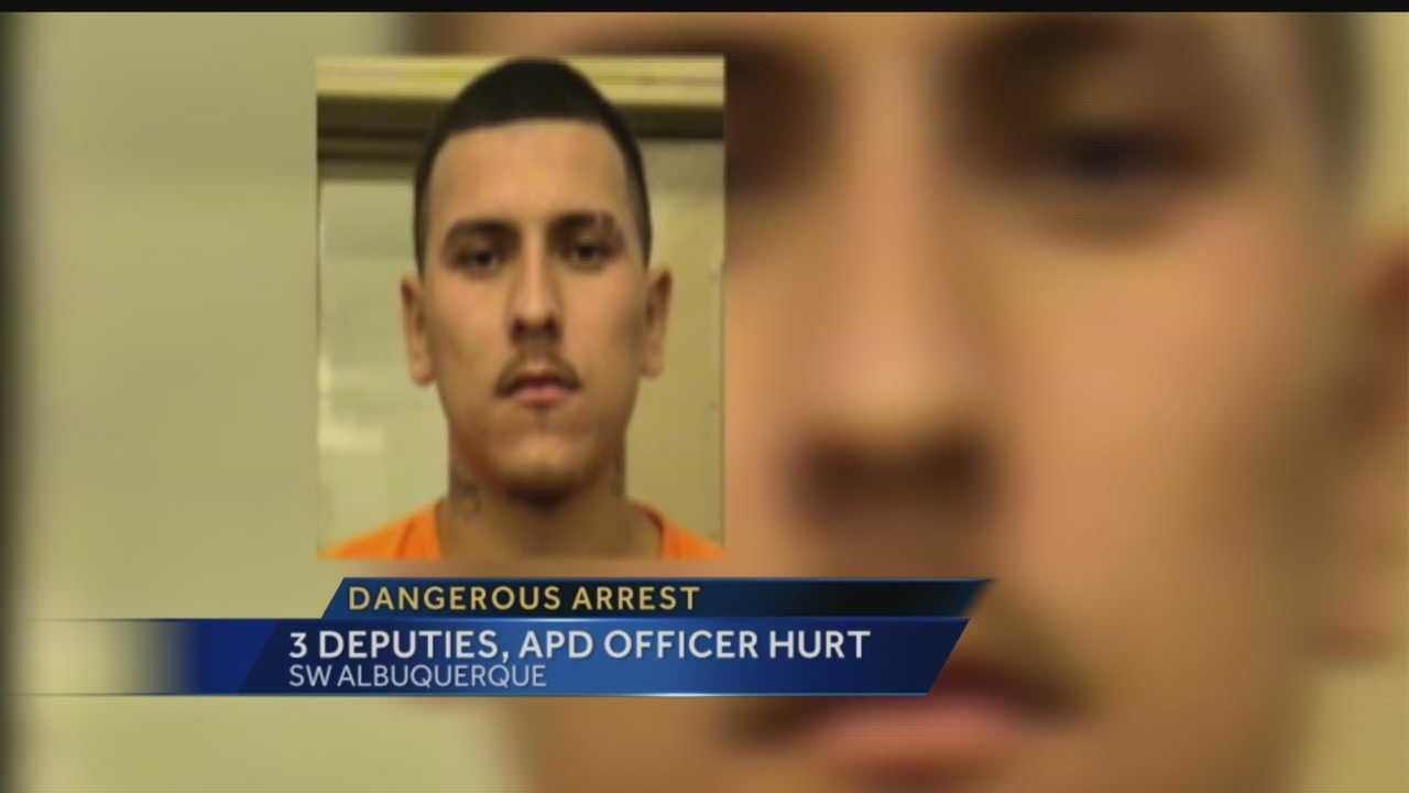 Investigators say a home invasion suspect injured 3 deputies and an Albuquerque police officer while trying to escape.