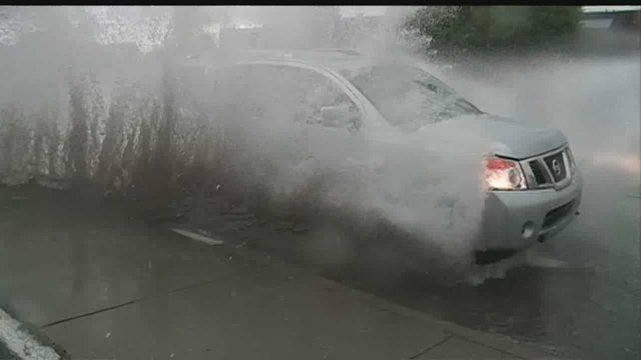 Record-breaking rain soaked Albuquerque Wednesday evening, flooding the streets and filling the arroyos.