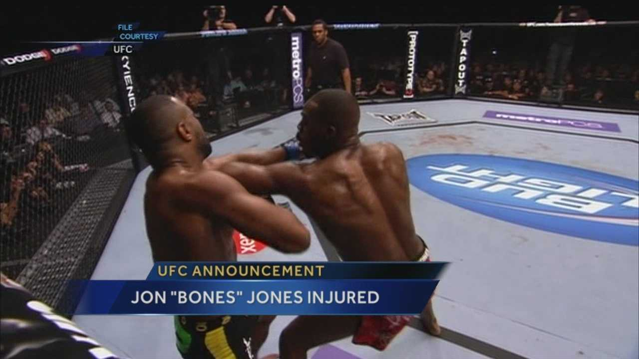 "UFC light heavyweight champion Jon ""Bones"" Jones is on the sideline after getting hurt in training."