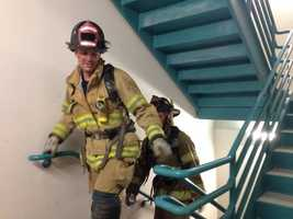 To simulate what firefighters went through on 9/11, they had to climb the stairs of the building five times.