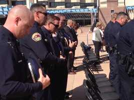 APD officers in attendance bowed their heads during a moment of silence.