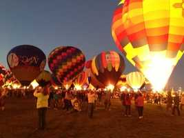 Watch an evening balloon glow at Balloon Fiesta