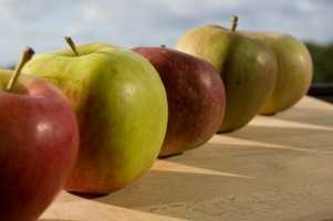The magazine says biting and chewing an apple stimulates saliva production, reducing decay by lowering bacteria levels.