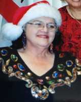 Doug's mom liked to be Mrs. Claus with her red Santa hat over the years.