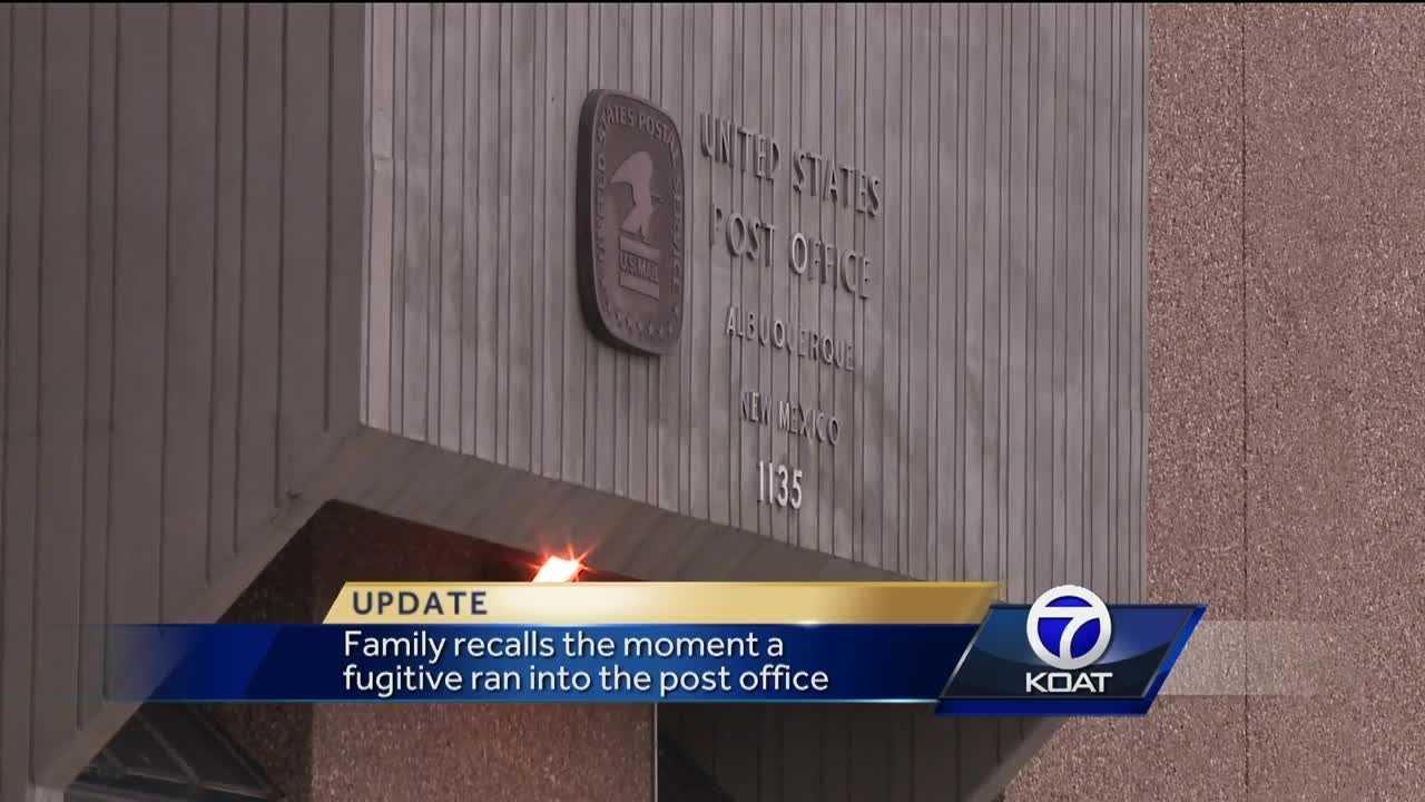 An armed murder suspect ran from authorities near downtown Albuquerque Friday evening.