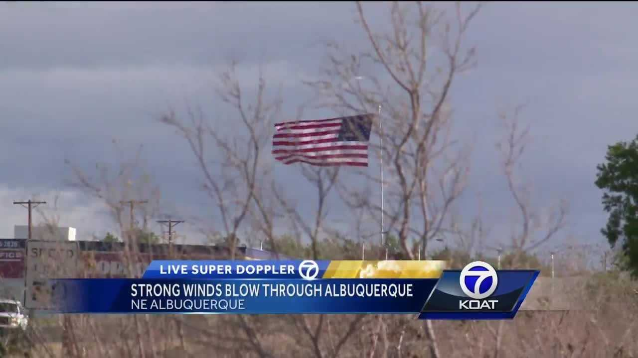 Strong winds blew through Albuquerque today, even causing damage to signs and houses.