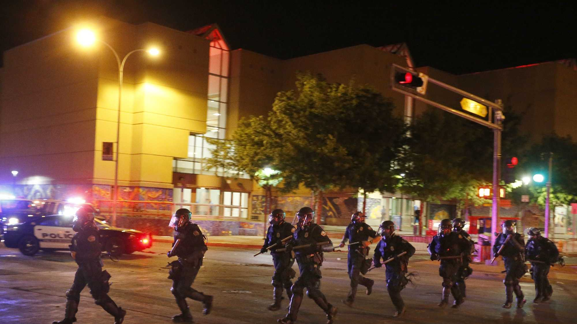 Riot police respond to anti-Trump protests following a rally and speech by Republican presidential candidate Donald Trump, in front of the Albuquerque Convention Center where the event was held, in Albuquerque.