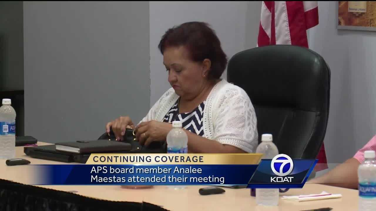 Board member attends meeting in midst of investigation