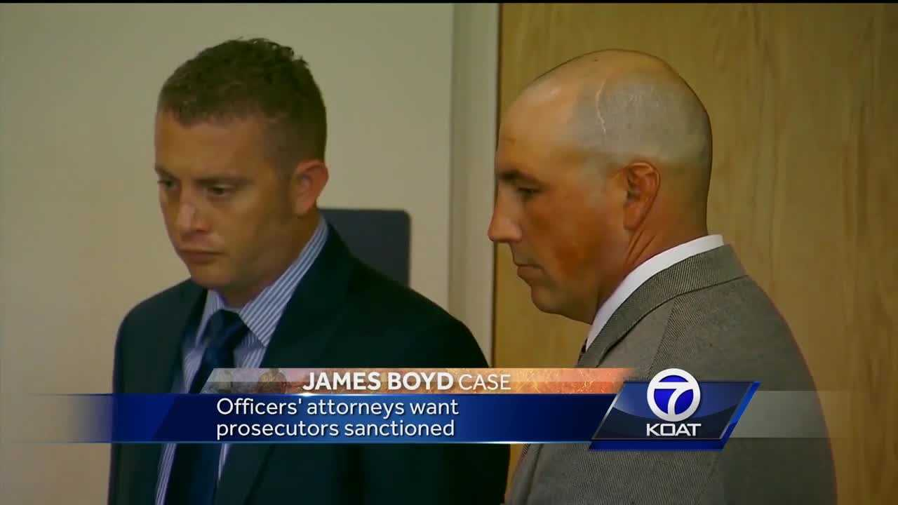 A Bernalillo County District Court judge could decide to move the trial of two former Albuquerque police officers, or dismiss the case altogether Tuesday.