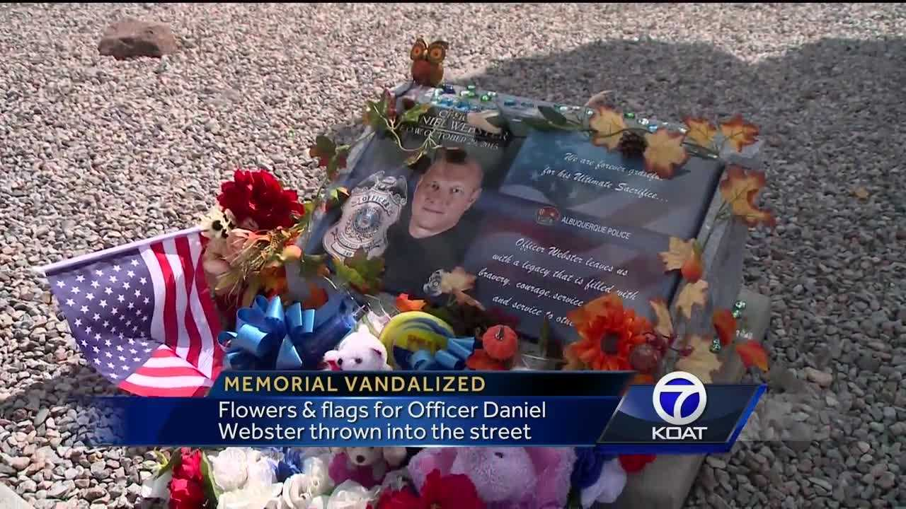 Flowers and flags for Officer Daniel Webster thrown into the street.