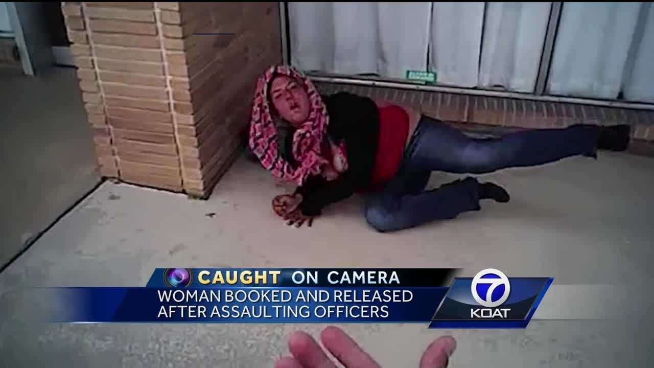 A homeless woman was released after being booked for assaulting officers.