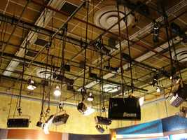 """LightsAbove the entire studio, there's a gigantic grid of lights. In addition to our in-house lighting specialists, an outside lighting expert was brought in to make sure our Action 7 News team look fabulous on the new set. The lighting team made sure these lights were placed in just the right positions. Each anchor has a different """"light set-up"""" to maximize his or her appearance."""
