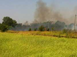 Firefighters battle a grass fire near the Will Rogers World Airport in southwest Oklahoma City. KOCO's Kim Passoth snapped these photos.