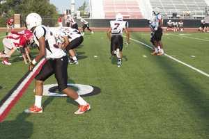 Putnam City Original quarterback Devin White sent his receiver into motion before the snap.