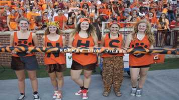 The Tigers prepare for the pregame spirit stick swap, a tradition before the Crosstown Clash.