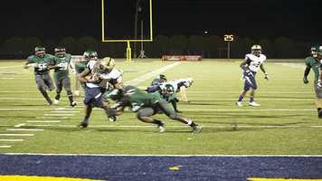 Spead gets leg tackled by Santa Fe linebacker Phillip Sumpter (1).