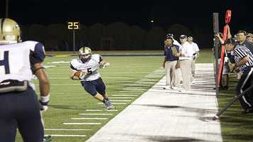 Jackson Stalling (5) carries the ball downfield after catching a screen pass from quarterback Tre Edwards.