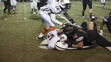 Knox (5), is finally brought down by Jaguars' tackler, Josh Morgan (14).