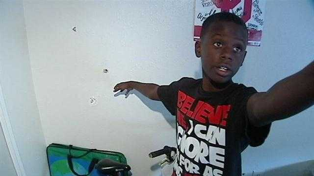 Boy saves brother as home riddled with bullets