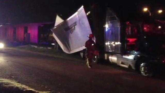 Raw Video: Semi drives through Del City building