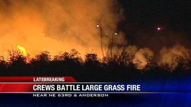 Crews battle large grass fire