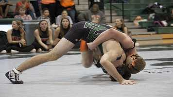 Norman North wrestler Austin Wright (Bottom) defends a takedown attempt from opponent Jeffery Adams.