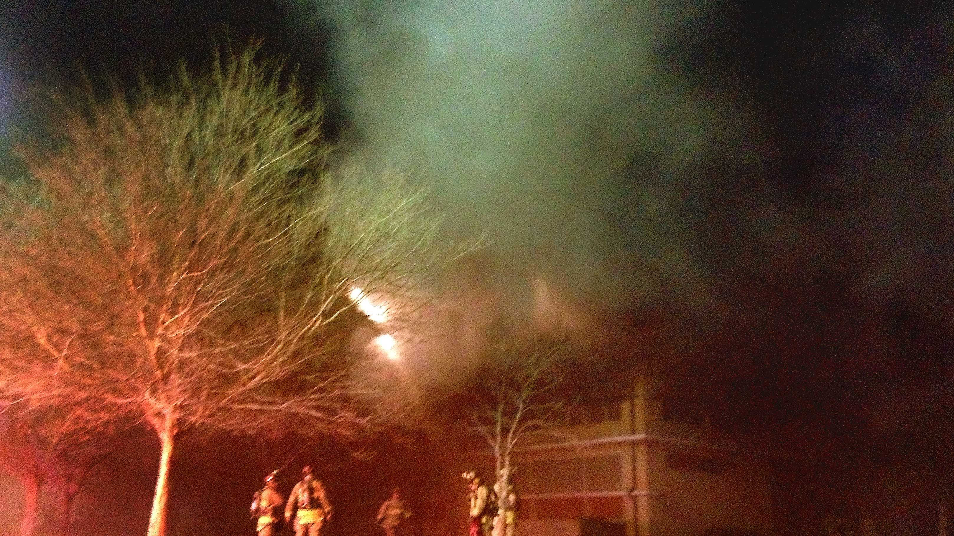 Firefighters battle a blaze at the old John Marshall High School building.