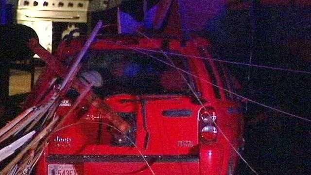 Power pole dangling after crash