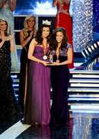 Miss America 2012 Laura Kaeppeler awards Miss Oklahoma Alicia Clifton with her talent competition award.
