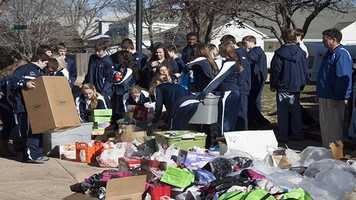 Students grab donations to load into the truck used to take donations to Catholic Charities.