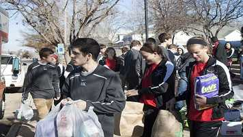 Bishop Kelley students walk to the truck to load donations.