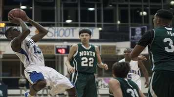 Spartans Romello Robertson (13), takes a shot while falling backwards against Norman North.