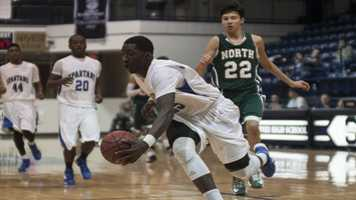 Rashawn Thomas (25) makes the save and keeps the ball in-bounds during the tournament final game against Norman North.