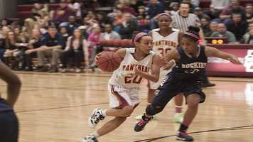 Putnam Norths Michciah Tyler (20), runs toward the lane as she eyes the basket.